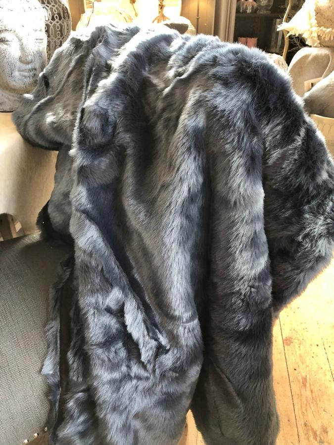 Blue faux-fur throw